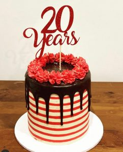 Kai + Co Studio anniversary cake topper
