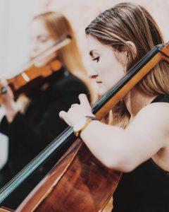 Q Strings Trio in motion