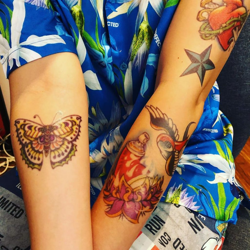 Shimmer Squad arm tattoos