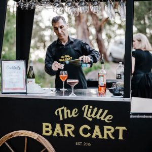 The Little Bar Cart pouring drinks