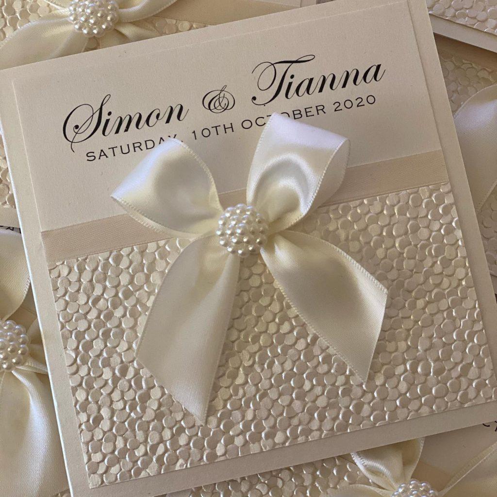 Invitations By Seda bow